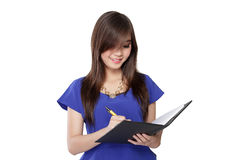 Asian girl write a note in a book Stock Photography