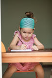 Asian girl writing in the notebook Royalty Free Stock Photography