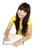 Asian Girl Writing On A Book Stock Images