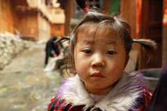 Asian girl 4 years old, close-up portrait on rural street. Stock Photos