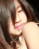 Young Female Model. Young Asian girl looking over her shoulder Stock Photo
