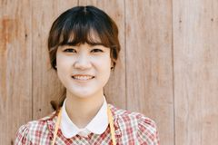 Asian Girl young teen hipster closeup head happy smile vintage. On wood background Stock Photos