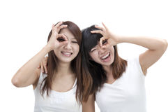 Asian girls. Friend having fun and making funny faces royalty free stock photo