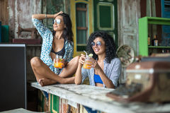 Asian girls in bar Royalty Free Stock Photo