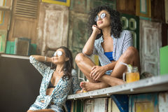 Asian girls in bar Stock Photography