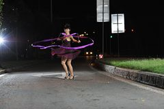 Asian girls dancing ballet on the road at night stock images