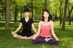 Asian girls doing yoga royalty free stock photos