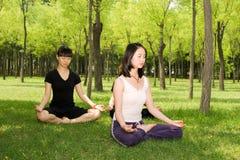 Asian girls doing yoga royalty free stock image
