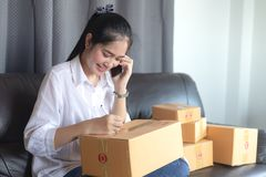 Asian girls get the order by phone, Online shopping young start stock photography
