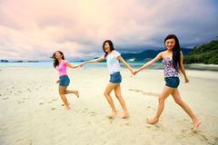 Asian girls have fun at the beach stock image