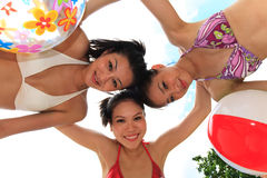 Asian girls have fun under the sun Royalty Free Stock Images