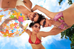 Asian girls have fun under the sun Stock Images