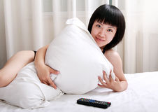 Asian girls lying on bed Royalty Free Stock Images