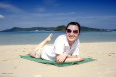 Asian girls lying on the phuket beach Stock Photos