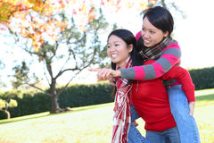 Asian Girls in Park Having Fun Royalty Free Stock Image