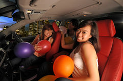 Asian girls party night out. Three asian girls having a good time driving their cars out Stock Photography