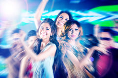 Asian girls partying on dance floor of disco nightclub. Asian beautiful friends dancing on disco floor having fun at fancy night club Royalty Free Stock Images