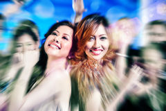 Asian girls partying on dance floor of disco nightclub. Asian beautiful friends dancing on disco floor having fun at fancy night club Stock Photography