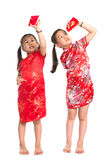 Asian girls peeking into red packet Royalty Free Stock Photo