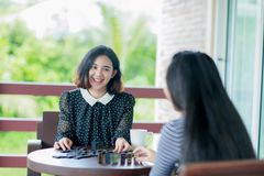Asian girls playing domino game Royalty Free Stock Photography