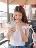 Asian girls playing phone stock photos