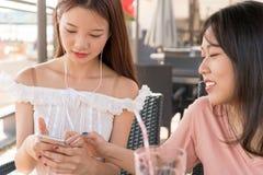 Asian girls playing phone royalty free stock image