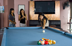 Asian girls playing pool Stock Photo
