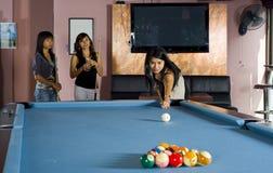 Asian girls playing pool Stock Photo