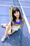 Asian girls playing tennis Stock Photos