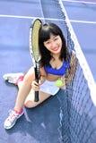 Asian girls playing tennis stock photos