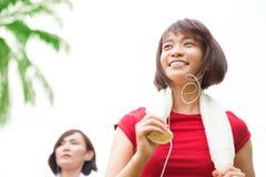 Asian girls running. At outdoor park royalty free stock photo