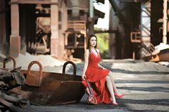 Asian girls show their beauty in abandoned factories stock photography
