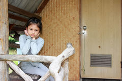 Asian girls sitting sadly on the old house balcony. stock images