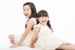 Asian girls sitting on the white background Royalty Free Stock Photos