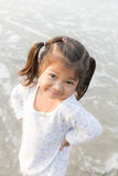 Asian girls smiling happily on the beach Stock Photography