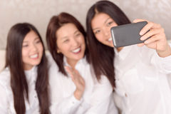 Asian girls and there mommy doing selfie Royalty Free Stock Photo