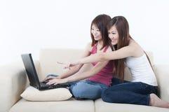 Asian girls using laptop Royalty Free Stock Photo