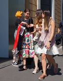 MILAN, ITALY -JUNE 18, 2018: Asian girls walking in the street after AALTO fashion show stock photo