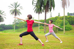 Asian girls yoga outdoor Royalty Free Stock Photos