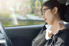 Asian business woman having pain on her shoulder, back and neck. Royalty Free Stock Photography