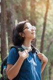 Asian glasses woman hiker with backpack breathing nature fresh a Stock Photography
