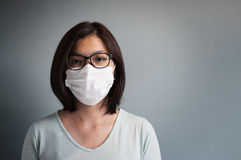Asian glasses woman wear medical mask. With copy space stock image
