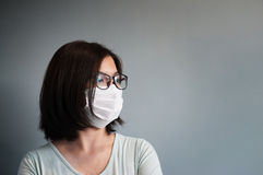 Asian glasses woman wear medical mask Stock Photo