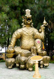 Asian gold mythological statue Stock Photo