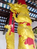 Asian golden dragon on red column Royalty Free Stock Image