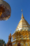 Asian golden pagoda with the umbrella Royalty Free Stock Photos