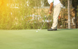 Asian golfers hit sweeping and keep golf course in the summer fo. R relax time,soft focus and blurry Stock Images