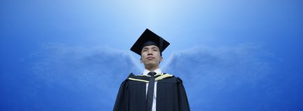 Asian graduate angel wings Royalty Free Stock Photos