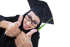 Asian graduate give thumbs up - isolated Royalty Free Stock Images