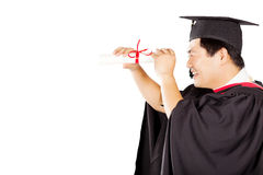 Asian graduate looking Stock Photo